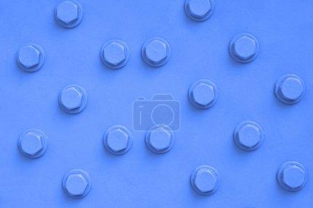 Photo pour Surface métallique et tête de boulon, peut être utilisé comme fond - image libre de droit