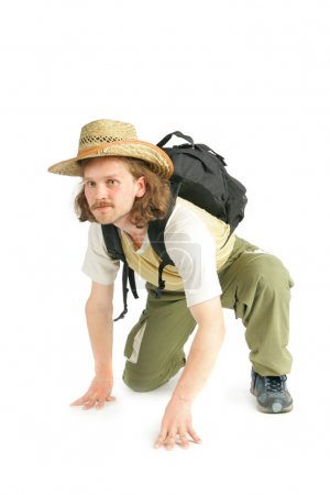 Man with straw hat and rucksack