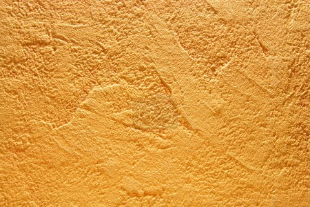 Texture of the yellow wall close-up...