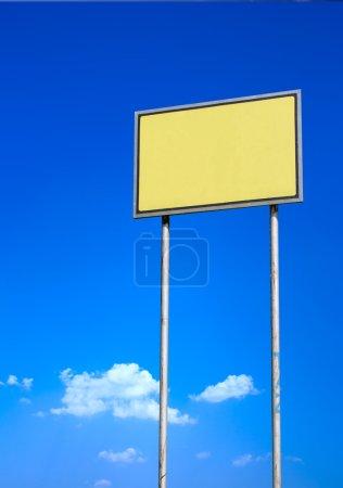Blank sign against blue sky