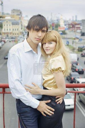 Portrait of couple in love on the bridge