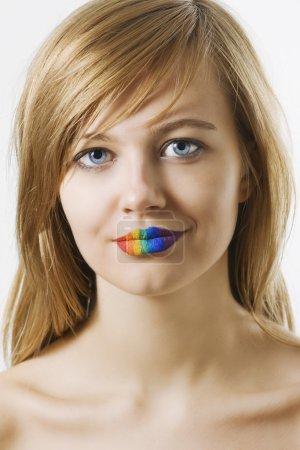 Woman with rainow lipstick , gay flag symbol...