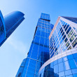 Modern blue skyscrapers towers in business centre perspective view