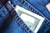Blue jeans pocket with hundred banknote