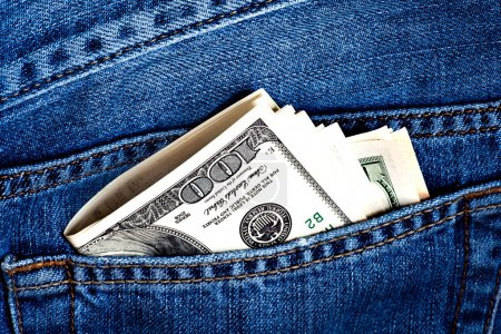 Jeans pocket with dollars banknotes