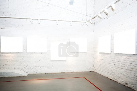 Brick wall in museum with frames