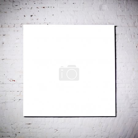 White frame on white brick wall