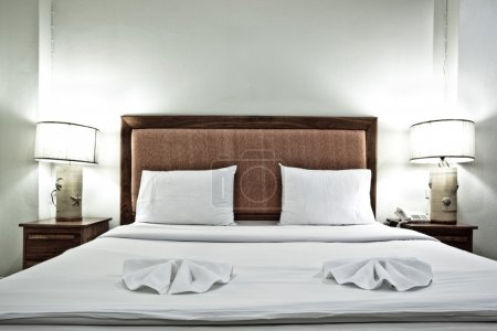 Hotel bedroom interior with pillows and