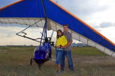 Couple with paraglide