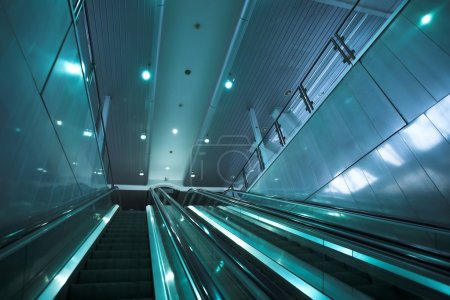 Moving escalator in the office hall