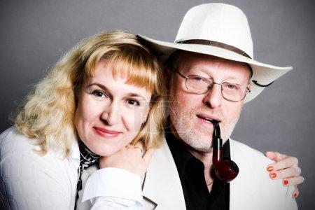 Smiling adult couple in studio