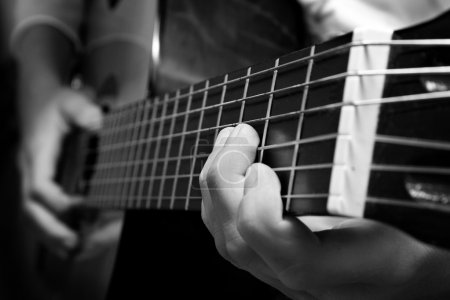Photo for Close-up view of guitar and musician's hands - Royalty Free Image