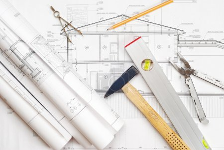 Photo for Tools over house plan blueprints - Royalty Free Image