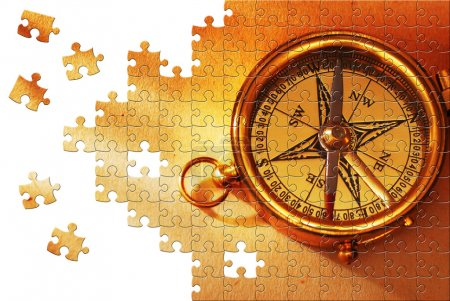 Photo for Puzzle Antique brass compass over old map background - Royalty Free Image