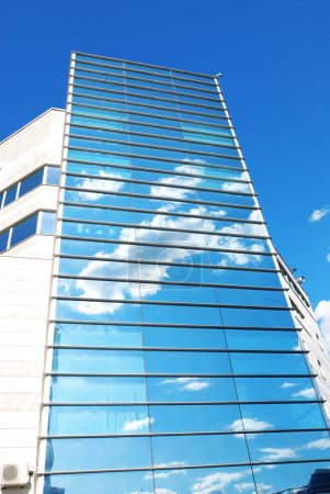 Photo for Modern office building with sky reflection in windows - Royalty Free Image