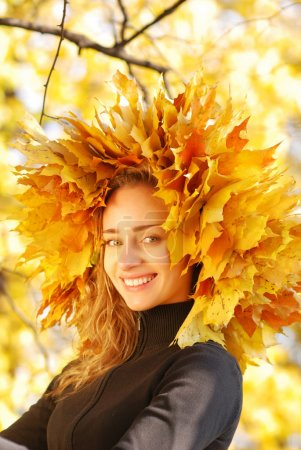 Photo for Girl with yellow autumn leaves - Royalty Free Image