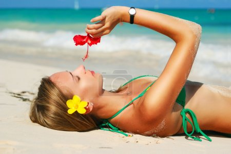 Photo for Girl with flower on caribbean beach - Royalty Free Image