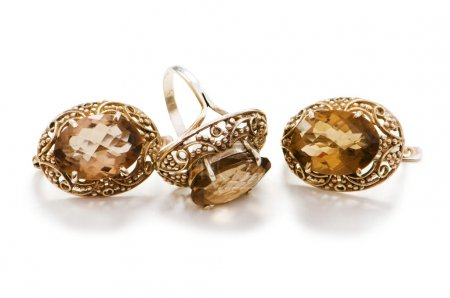 Golden ring and earrings isolated