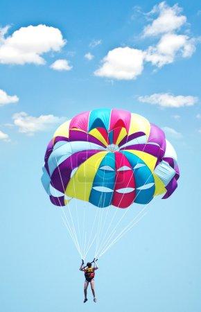 Multi coloured parachute over the sky