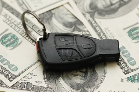 Photo for Car remote over the hundred dollar banknotes - Royalty Free Image