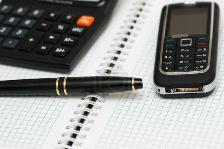 Calculator, ballpen and mobile phone