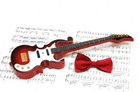 Musical notes, guitar and bow tie