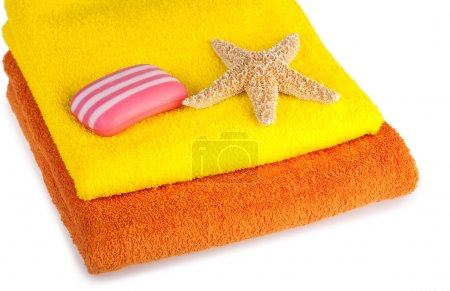 Colour terry towels, soap and starfish