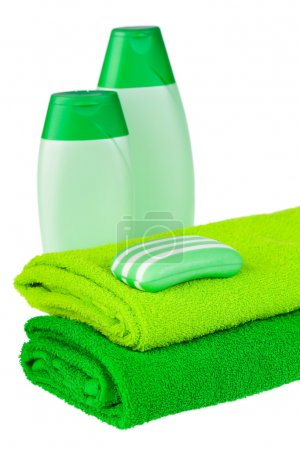 Green terry towels, soap and shampoo