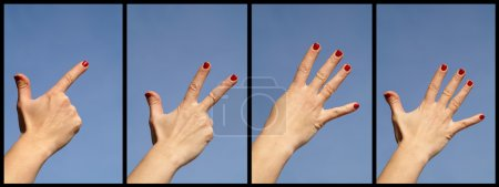 Photo pour Quatre bras dans le ciel bleu - image libre de droit
