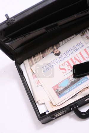 Briefcase with a newspaper