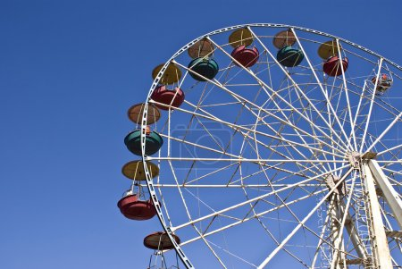 Big wheel on a background of the blue sk
