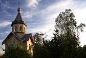 Orthodox chapel on a evening sky backgr