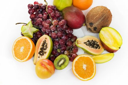 Photo for Healthy fruit assortment with papaya, kiwi, orange and grapes - Royalty Free Image