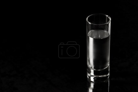 Photo for Drink series: glass of Russian vodka over black - Royalty Free Image