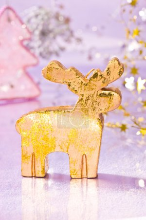 Photo for Holiday series: christmas golden deer with decorated fir - Royalty Free Image
