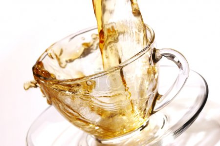 Photo for Pouring tea into glassy tea cup - Royalty Free Image