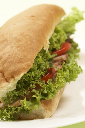 Photo for Fast food: big sandwich with ham and vegetables - Royalty Free Image