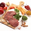 Foodstuff: meat and vegetables on the wood board...