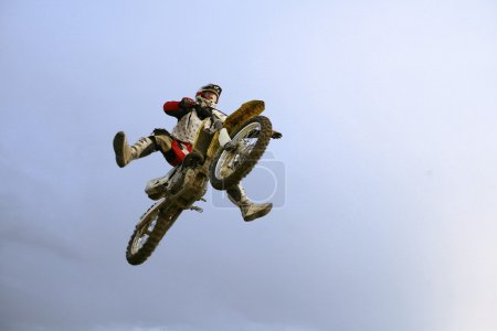 The motocross rider jumping over photogr