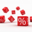 Symbols of percent on falling red cubes....