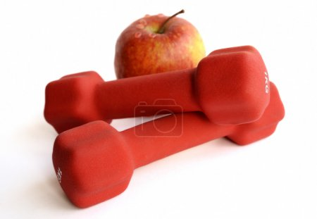 Red dumbbells with apple