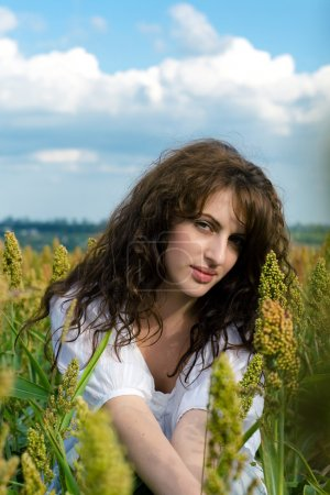 Woman in the field with wavy hair