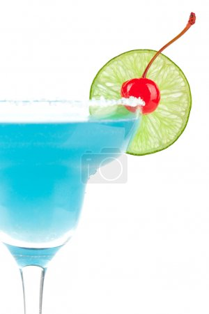 Blue cocktail with cherry and lime slice