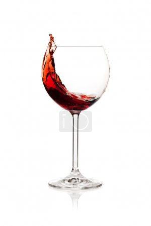 Splashing red wine in a glass