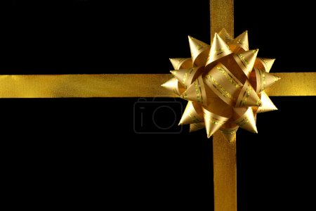 Photo for Big yellow holiday decoration on black background - Royalty Free Image
