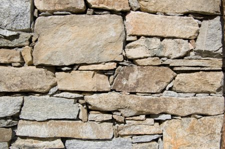 Photo for A wall of a rural mountain house made of stones - Royalty Free Image