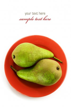 Photo for Yin and yang symbol - Two green pears on a red plate over white. With sample text - Royalty Free Image