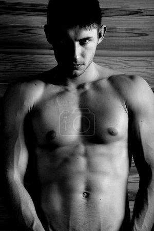 Photo for Serious man posing and looking at camera photo. - Royalty Free Image
