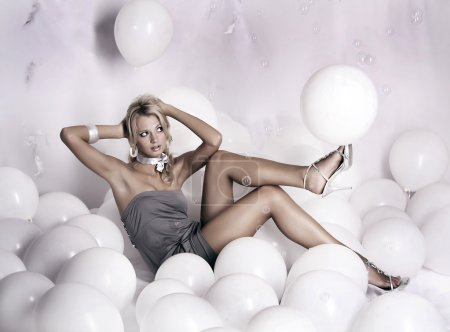 Photo for Portrait of beautiful young glamour girl with white balloons on grey background - Royalty Free Image
