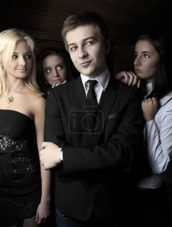 Photo for Stylish man and three women behind him. Conceptual photo. - Royalty Free Image